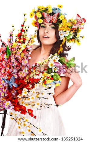 Girl with butterfly and flower on head.  Isolated.