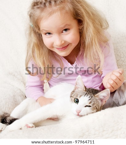 Girl with cat. Child with pet at home