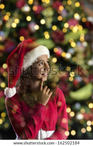 Girl with christmas hat  on black background