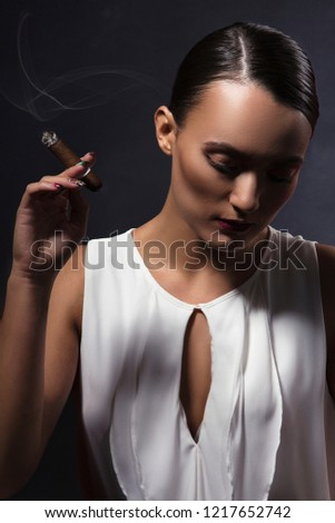 Girl with cigar portrait. Old hollywood gangster movie fashion style style