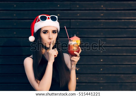 Girl with Cocktail Drink Keeping a Secret at Surprise Christmas Party - Woman with finger on her lips at Xmas celebration event