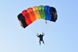 girl with colorful parachute in Thai navy parachute team