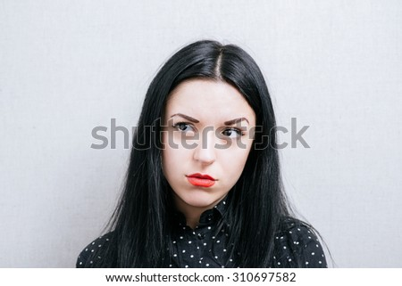 Girl with condemning glance #310697582