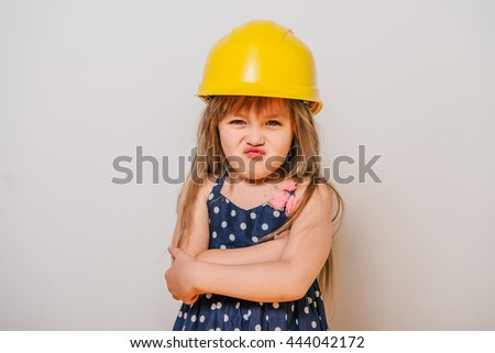 1a0457125dc girl with construction tools. Little girl in polka-dot dress. little girl in
