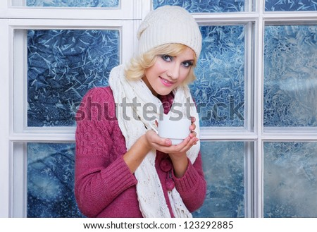 girl with cup onthe window