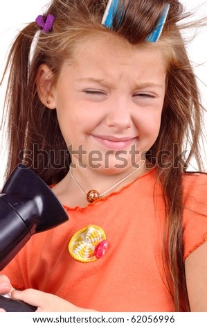 Girl with developing hair and hairdryer