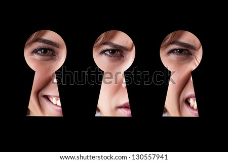 Girl with different emotions looks in a keyhole