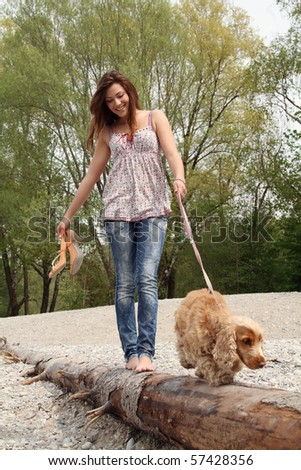 girl with dog in nature - stock photo