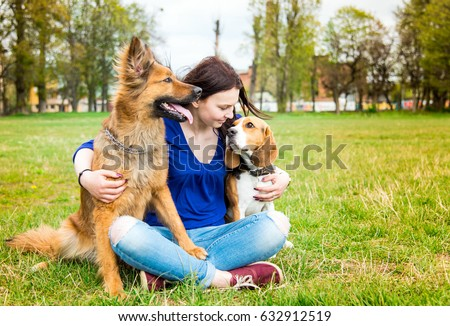 Girl with dogs in the park  #632912519