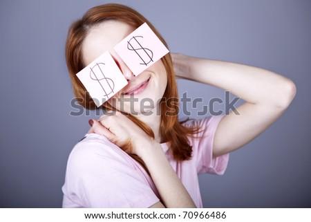 Girl with dollars symbol on eyes.