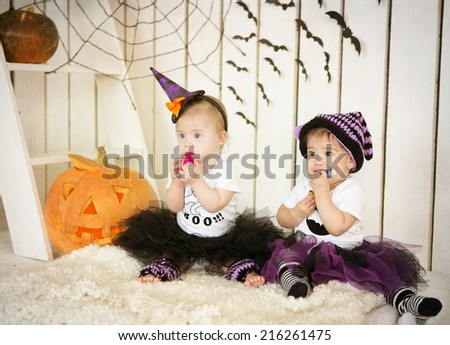 Girl with Down syndrome and her friend eat candy on a holiday halloween