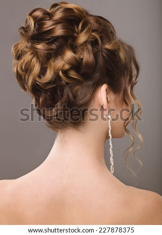 Girl with evening or wedding hairstyle. Picture taken in a studio.