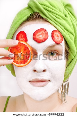 girl with face mask and fruits