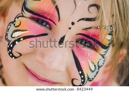 Girl with face painted