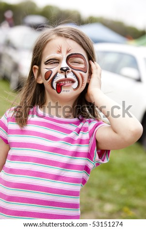 girl with face painted as a dog - stock photo