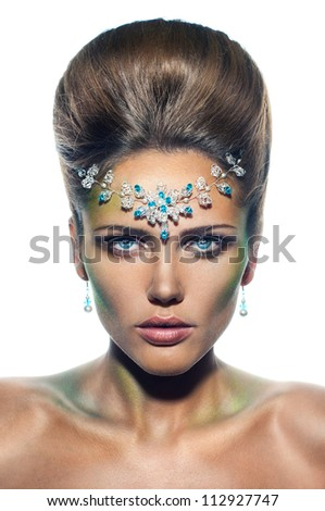 Girl with fashion hairstyle and tiara with blue stones