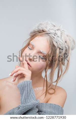 girl with fashion weaving. Snow hairstyle. white art makeup. beauty editorial. winter girl. angel makeup. white manicure. self-knowledge, meditation, yoga, pleasure