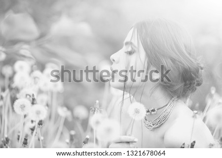 girl with fashionable makeup and beads in green leaves and dandelion flower on natural background, beauty and fashion, youth and freshness #1321678064