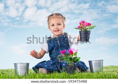 girl with flowers on green grass under sky #593475488