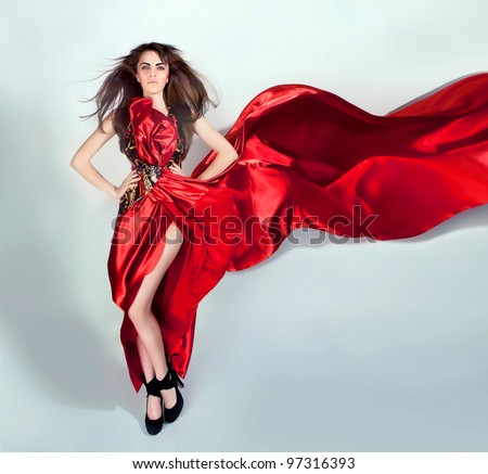 girl with flowing hair in the red dress