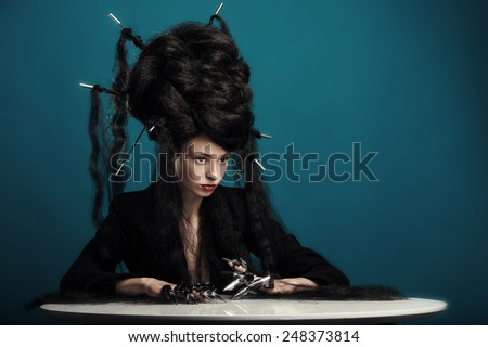 girl with fluffy hair sitting at the table