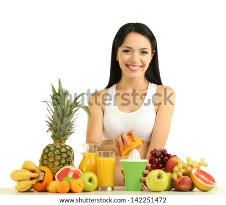 Girl with fresh fruits and juice isolated on white