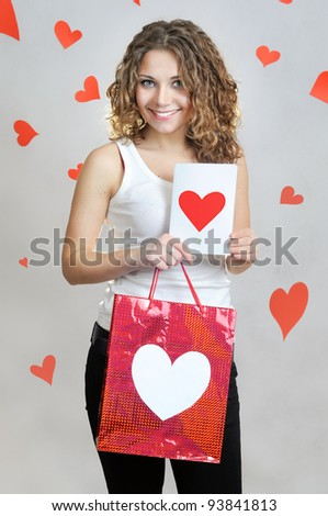 Girl with gift bag and greetings card