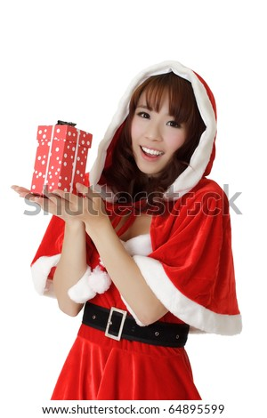 Girl with gift in Christmas, closeup portrait of happy Asian woman in Santa Claus clothes.