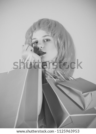 girl with gifts. Sale and black friday. Woman with shopping bags. Fashion shopper posing on pink background. Girl wearing red wig. Holidays celebration concept. #1125963953