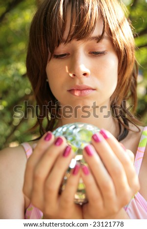 Girl with glass ball in hands