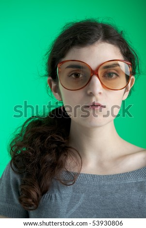 girl with glasses on green