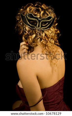 Girl with gold hair and mask on black