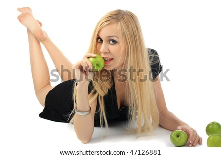 girl with green apple on isolated background