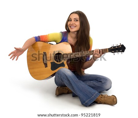Girl with guitar and long hair on a white background - stock photo