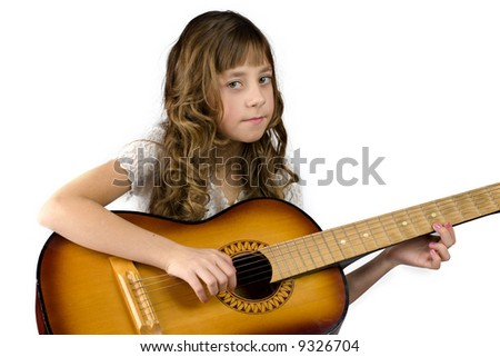 Girl with guitar looking at you isolated on white