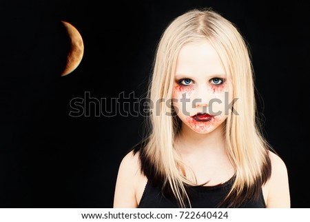 Stock Photo Girl with Halloween Makeup. Portrait of Teen Girl with Artistic Make up and Moon on Black Background