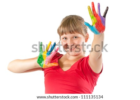 Girl with hands painted in colorful paints - stock photo