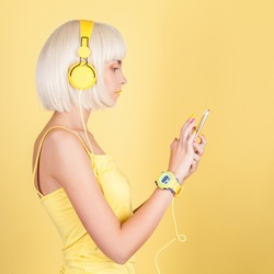 Girl with headphones and a phone