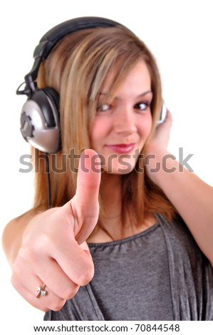 Girl with headphones and thumb up isolated over white background