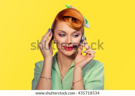Girl with headset Closeup red head beautiful young woman pretty happy smiling pinup girl green button shirt holding microphone earphone with one hand looking at you camera retro vintage 50's hairstyle