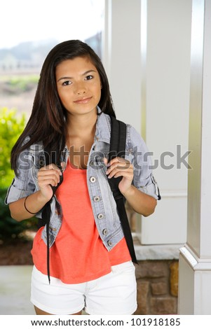 Girl with her backpack going to school