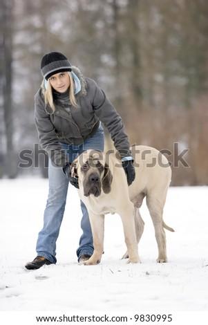 Girl with her english mastiff dog. - stock photo