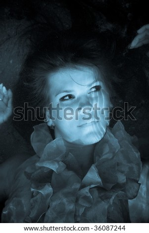 girl with her eyes open is under water