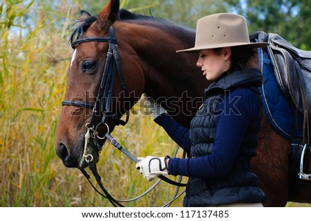 Girl with her horse.