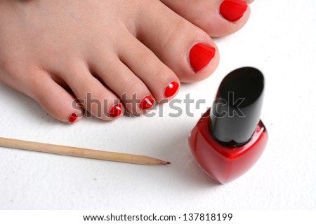 Girl with her nails painted a red color