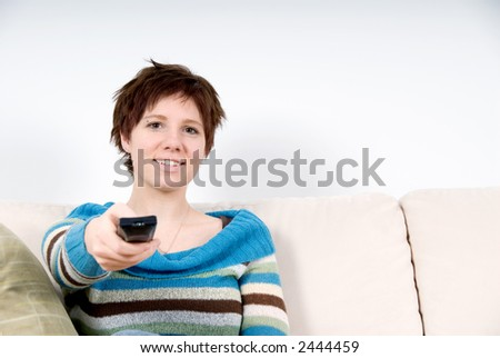 girl with her tv remote control on the couch
