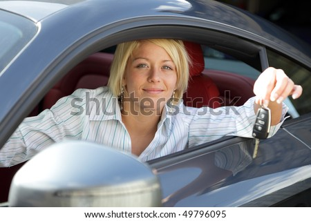 Girl with keys of a new or rental car or having just passed her driving test