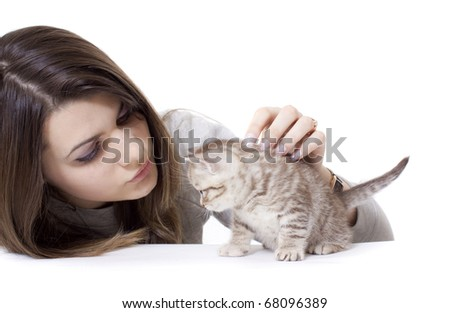 Girl with kitty on white background
