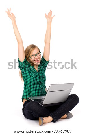 Girl with laptop raising her arms in joy