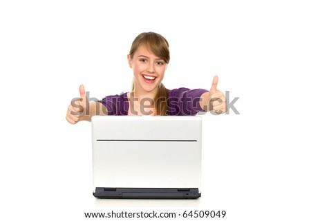 Girl with laptop showing thumbs up - stock photo